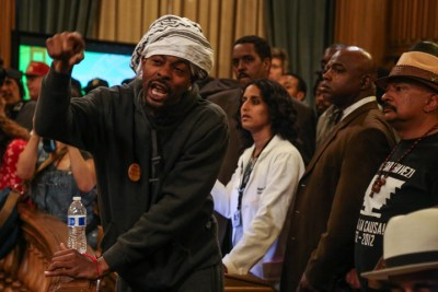 In one of the most dramatic of the many confrontations during the hunger strike, the Frisco 5, after leading a march from the Mission to City Hall in their wheelchairs and finding that Mayor Ed Lee had stood them up, interrupted the weekly meeting of the full Board of Supervisors. Sellassie made an impassioned plea for the firing of Chief Greg Suhr – and won the support of several supervisors. – Photo: Natasha Dangond, Guardsman