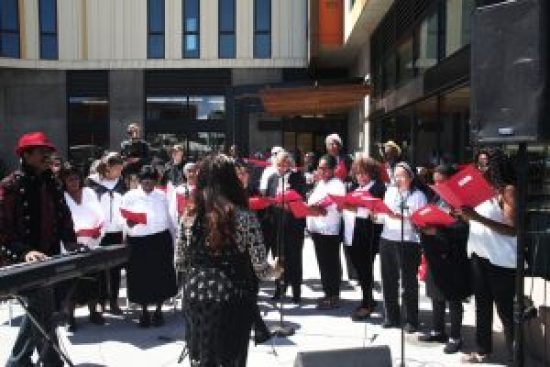The Bayview-Western Addition Combined Community of Voices Choir, led by Choir Director Maestro Curtis, performs to the delight of the audience. Dr. Davis' vision included more opportunities for the public to enjoy the rich talent trove among seniors in Bayview Hunters Point. – Photo: PhotoArtist Gene Hazzard