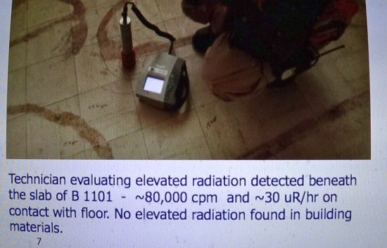 A technician measures the radiation under the floor slab of a home on Treasure Island at 80,000 cpm.