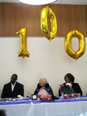 "The brand new Dr. George Davis Senior Center went all out with lavish decorations, including balloons spelling ""100,"" for Ms. Pickens' 100th birthday party on June 11. It's not often there's such a great milestone to celebrate! – Photo: Anh Le"
