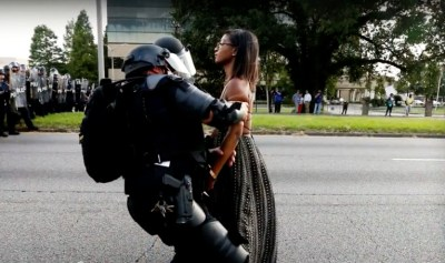 "The FBI works through local law enforcement to shut down dissent. Here, Ieshia Evans is detained during a demonstration near police headquarters in Baton Rouge on July 9, 2016. When the 28-year-old mother of a 6-year-old, who'd never before been an activist, told her son she'd been arrested, he said, ""I thought only bad people go to jail."" – Photo: Reuters"