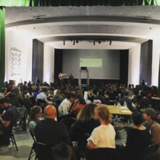 At a converted movie theater in the Mission, an anti-racism event called Let's Take Action drew a mostly white packed house on July 12. – Photo: LaRon L. Barton