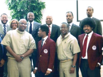 The USP Atlanta and Morehouse debate teams come together with federal and local officials for a group picture after the debate. Shown are the USP team – Dr. Belay D. Reddick, Edmond Phillips and Joseph Thompson – the Morehouse debate team, Morehouse College President John Wilson, their debate coach Ken Newby, and White House officials Michael Smith, Karol Mason and Dr. Ivory Toldson. – Photo: WADE