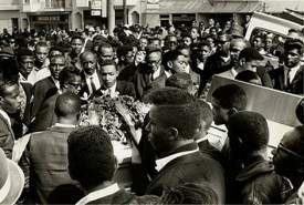 "The community turned out in force for the funeral of Matthew ""Peanut"" Johnson, 16, whose murder by SFPD on Sept. 27, 1966, 50 years ago, caused an explosion of protest known as the Hunters Point Uprising, the second major ""riot"" in the U.S. of the turbulent '60s. Note that, unlike in many other cities, protesters did not destroy their own, then mostly Black-owned neighborhood. – Photo courtesy SF Public Library History Center"