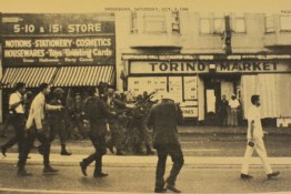 "Protesters, laying claim to Third Street, ""main street"" in Bayview Hunters Point, bravely walk past National Guard troops, described at the time as young, white and terrified, the kind of fear that can make an officer trigger-happy. – Photo: The Hunters Point Bayview Spokesman"