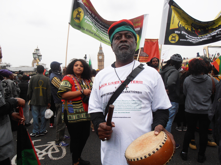 https://i2.wp.com/sfbayview.com/wp-content/uploads/2016/08/London-Reparations-March-Baba-Jahahara-on-Westminster-Bridge-3-min.-silence-for-ancestors-080116-by-Jahahara-web.jpg
