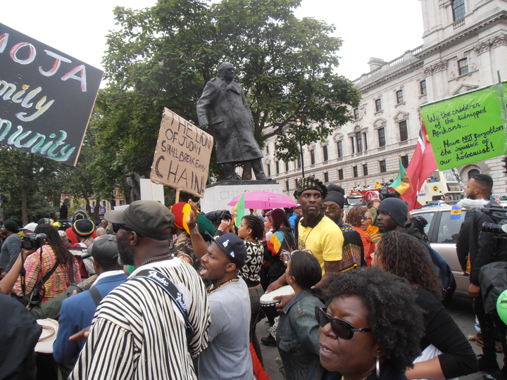 https://i2.wp.com/sfbayview.com/wp-content/uploads/2016/08/London-Reparations-March-PM-Winston-Churchill-statue-Parliament-Square-080116-by-Jahahara-web.jpg