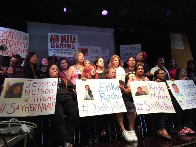 "Women ""shout their names"" at a CCWP event of that name, holding up women who have died at the hands of police and in prison, on July 31, 2016."