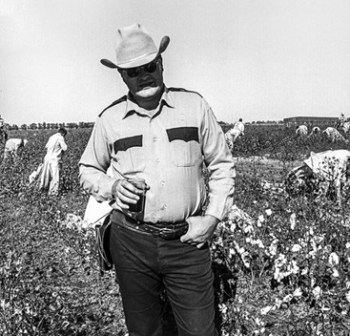Only the overseer's uniform and the modern photography tell us that this is 1975, not 1775. The prisoners are picking cotton on the Cummins Prison Farm in Texas, where many current prisons are former plantations. Texas and Georgia are the only states that pay prisoners nothing at all for their labor. – Photo courtesy The Marshall Project