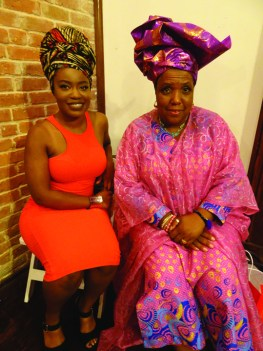 "Nigerian artist Juliana Kasumu and Big Queen of the Guardians of the Flame Mardi Gras Indians Cherice Harrison-Nelson were at Juliana's art reception ""From Moussor to Tignon: The Evolution of the Head-Tie"" at the McKenna Center of African American Art in New Orleans during the Black Arts Movement conference. – Photo: Wanda Sabir"