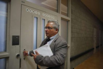 Juvenile Justice Center Director Luis Recinos walks into the Merit Center – ready but as yet unopened – at the Juvenile Justice Center's Woodside Learning Center on Wednesday, July 20, 2016. Recinos is reportedly eager to open the center. – Photo: Lea Suzuki, SF Chronicle