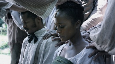 "Nate Parker as Nat Turner marries Aja Naomi King as Cherry in ""Birth of a Nation."""