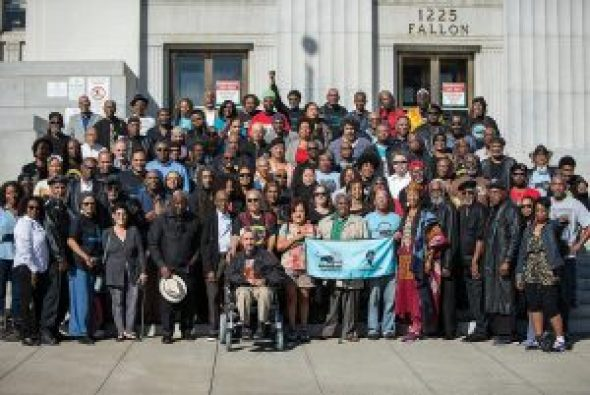 On this very special 50th anniversary, as for the last several anniversaries, Black Panther veterans gathered on the steps of the Alameda County Courthouse as they had for countless Free Huey rallies back in the day. These are the brave, young revolutionaries who inspired the world. There is great wisdom here. Listen to their stories. – Photo: Malaika Kambon