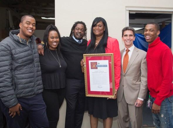 The whole family celebrates the honor bestowed on Yolanda's YCAT-C: from left, her son Raysean Jones Jr., daughter Lyn-Tise Jones, husband Raysean Jones Sr., Yolanda Jones, Sen. Mark Leno and son Rome Jones.