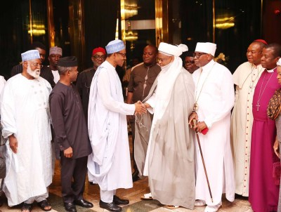President Buhari greets Lt. Gen. Abdulsalam Abubaka and Pastor Ayo Oritsejafor, heading the so-called National Peace Committee on Aug. 11, 2015. They pled with Buhari not to investigate the administration of former President Goodluck Jonathan. – Photo: State House