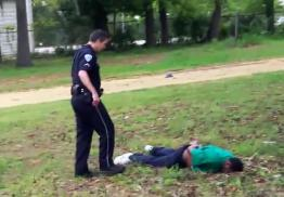 A nonchalant Slager stands over the body of Walter Scott, the man he just murdered.