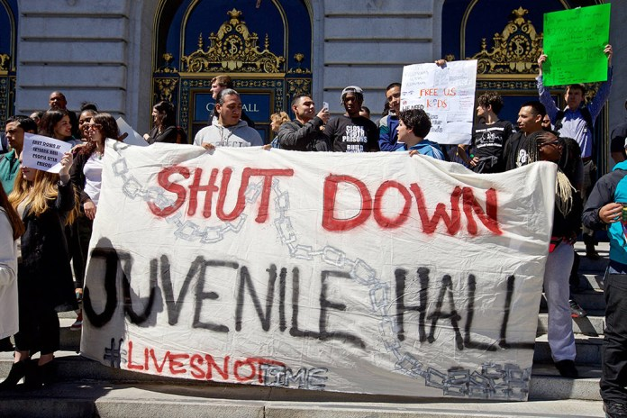 Rally-to-close-SF-Juvenile-Hall-by-2021-youth-hold-'Shut-Down-Juvenile-Hall'-banner-City-Hall-steps-040919-by-Kevin-N.-Hume-SF-Examiner, Youth and SF Board majority back Shamann Walton's proposal to close Juvenile Hall because 'all you learn is how to survive in prison', Local News & Views