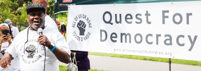 Dorsey-Nunn-speaks-backed-by-Quest-for-Democracy-banner-0918-by-Wanda, Freedom and Movement Center celebrates its first anniversary Aug. 31, Local News & Views