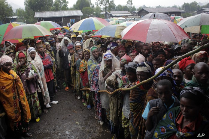 Internally-displaced-Congolese-await-World-Food-Program-'energy-biscuits'-in-Kibati-near-Goma-eastern-DRC-080812-by-VOA, Foreign aid for Rwanda, suffering for Rwandans and Congolese, World News & Views