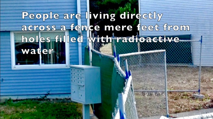Treasure-Island-residents-of-1238F-Northpoint-live-at-cleanup-zone-fence-by-Carol-Harvey, Navy removes an estimated 163+ new radiation deposits from two toxic dumps and dangerously radioactive soil from under occupied Treasure Island home, Local News & Views