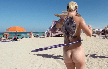 Young woman with hula hoop on Haulover Beach