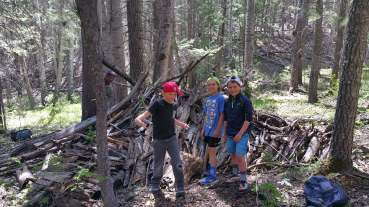 The boys with their awesome shelter!