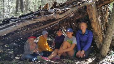 The girls with their awesome shelter!