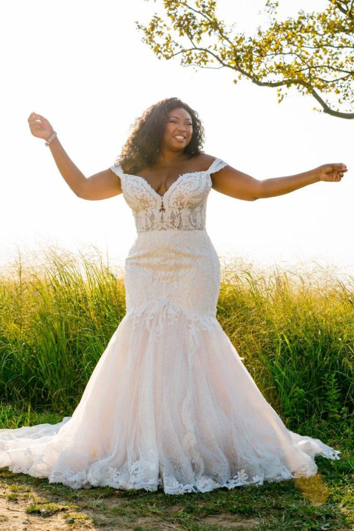 Bride Wearing Plus-Size Mermaid Wedding Dress Called Joss by Sottero and Midgley