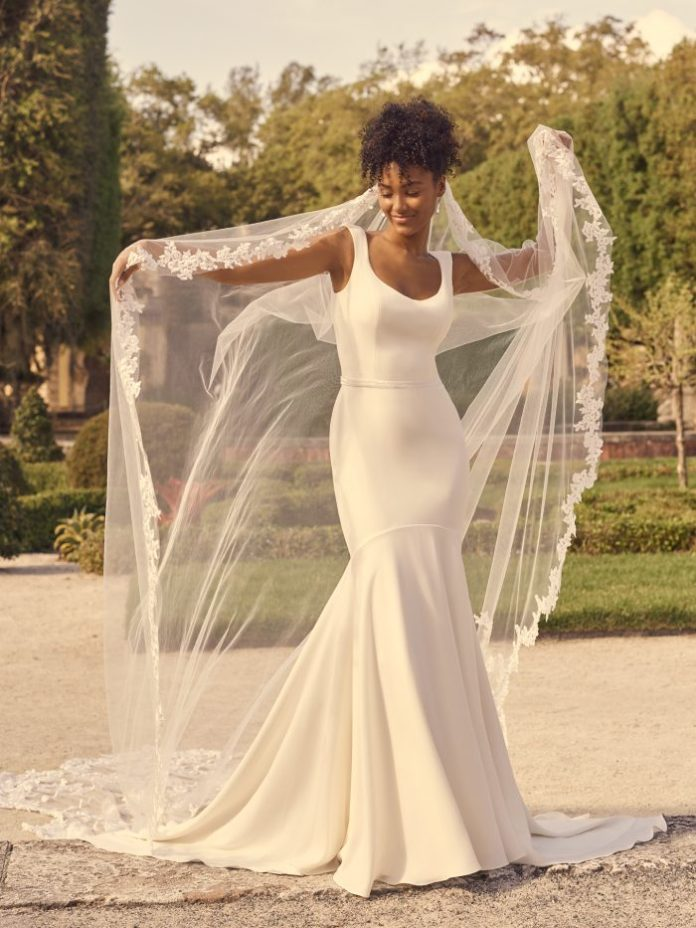 Bride Wearing Minimalist Crepe Wedding Gown with Tank Straps Called Astley by Maggie Sottero