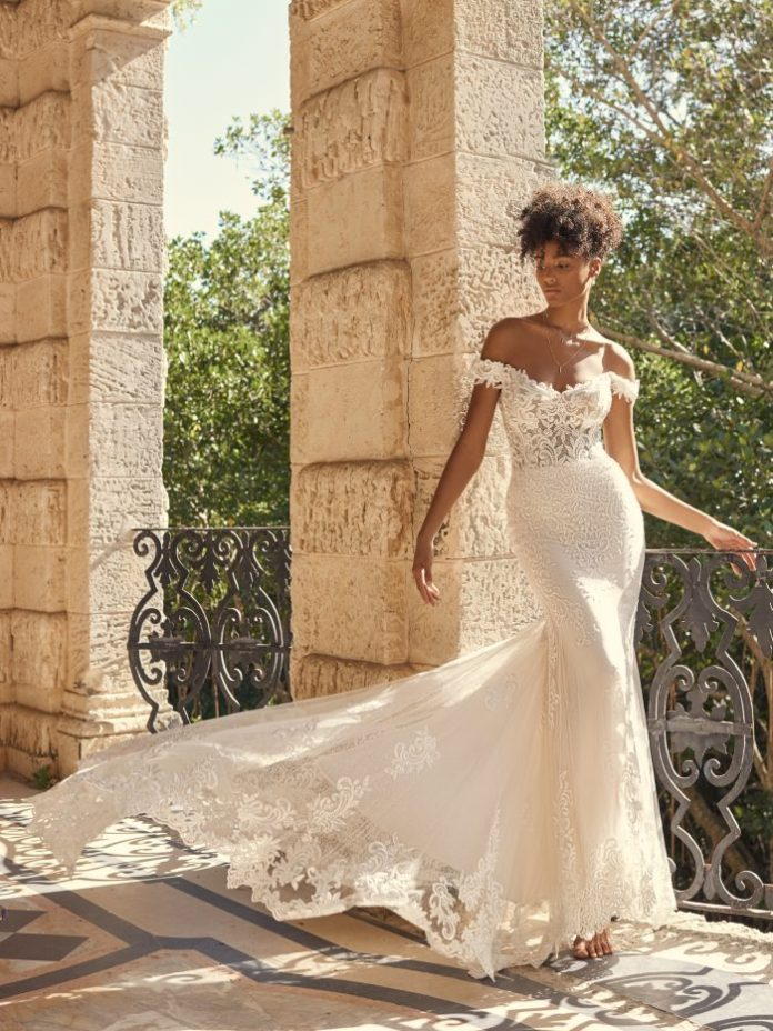 Bride wearing off shoulder mermaid wedding dress named Edison by Maggie Sottero