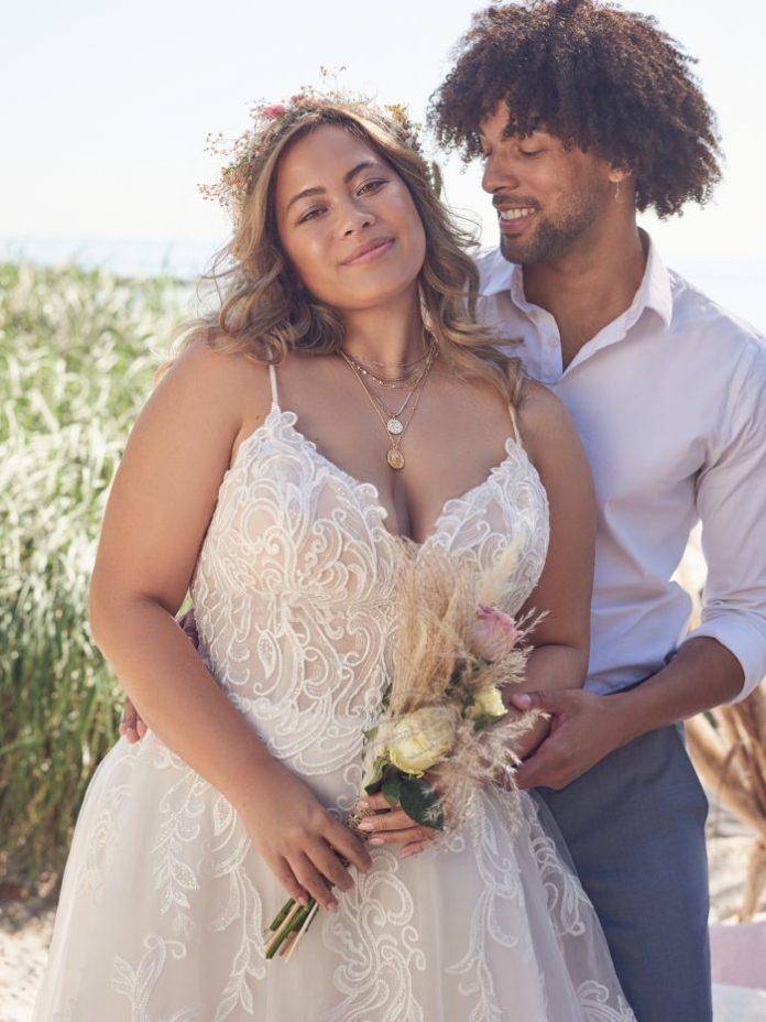 Groom with Bride Wearing Lace Plus Size A-line Wedding Dress Called Katiya by Rebecca Ingram