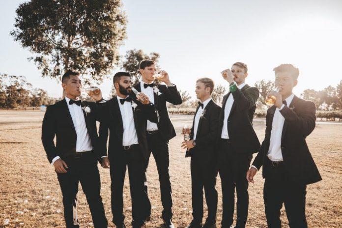 Groom with groomsmen at Vineyard Wedding in Western Australia in black tuxedos and bow ties