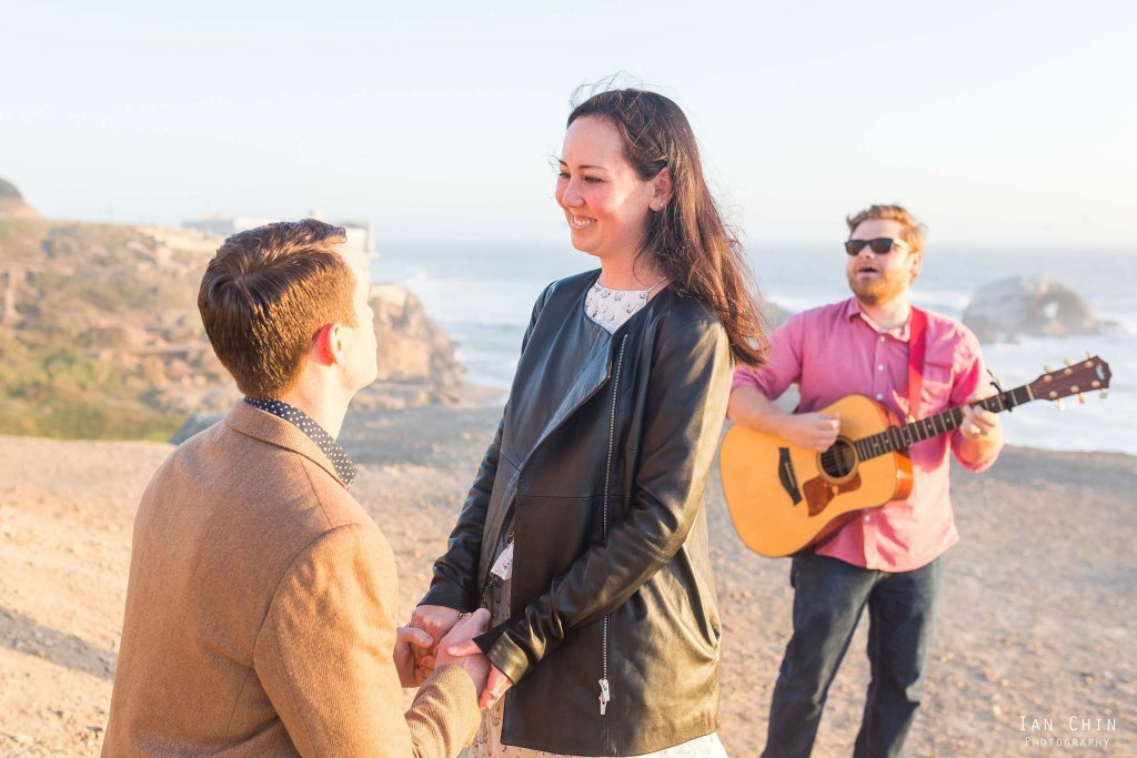 lands end point lobos marriage proposal at sunset with a guitarist singing in the background