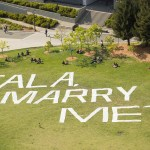 UC Berkeley marriage proposal words written in the green using paper with the words marry me?