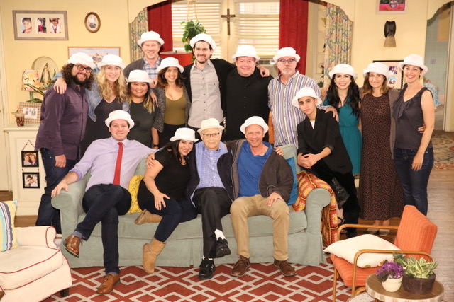 Norman Lear takes a photo with the writers on the set of One Day at a Time.
