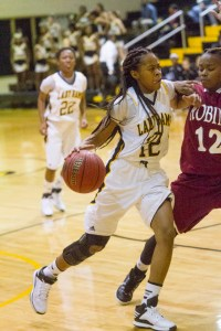 Worth's DeAundra Smith (12) drives against Dacien Ambler from Warner Robins.  Photo: Jessica Peters/SGSN