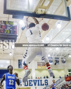 Tyrie Jackson dunks during the first quarter. Tift created turnovers in trap situations against the Lions backcourt for much of the first half. Photo: Shine Rankin Jr. /SGSN