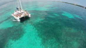 Sunset catamaran at Cancun coral reef