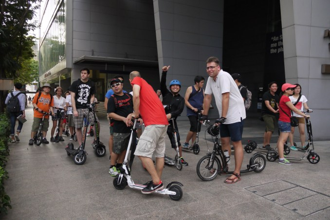 Community of electric and kick scooter riders gather in downtown Singapore