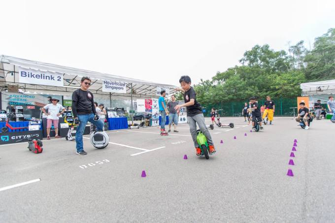 Kids performing unicycle slalom challenges