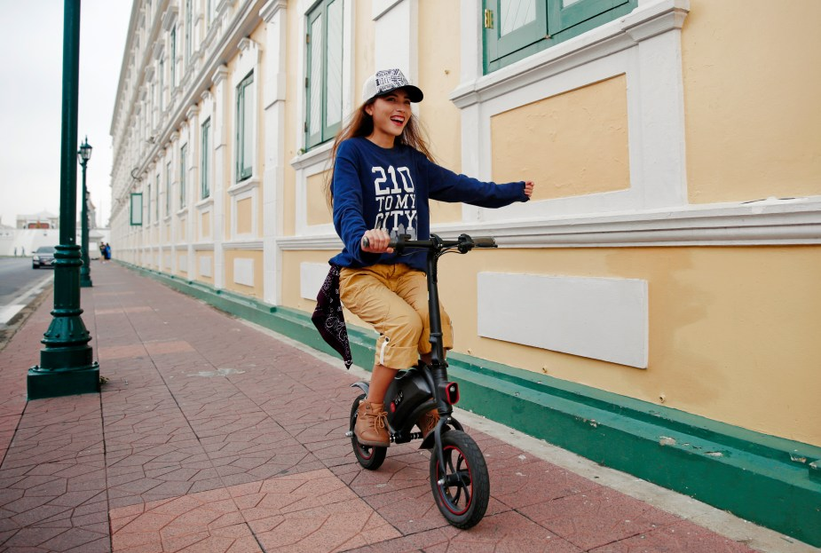 Girl on DYU seated e-scooter