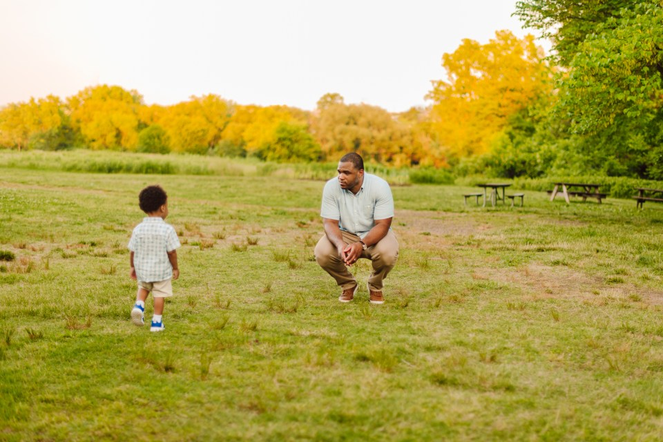 father and son play in bartram's garden