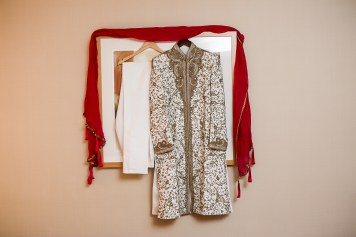 Gold, white and red Indian wedding clothes