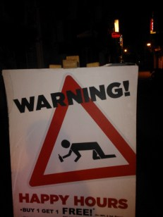 A Sign outside a pub, makes for funny entrances...or exits as the case might be!
