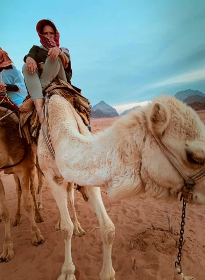 student from Shababeek center for spoken Arabic study on a camel in Wadi Rum