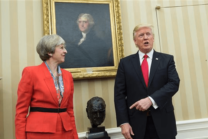 British Prime Minister Theresa May (L) and US President Donald Trump meet in the Oval Office of the White House on January 27, 2017 in Washington, DC. (Photo by AFP)