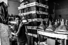 """Shahnawaz deals with the tubes business for the past 18 years. He owns a Honda city car and there are 8 workers, who work under him. Saleem is one of them. """" Lagta kachda hai bhaiya, lekin paisa bahut hai isme, Shahnwaz bhai ko dekh lo"""" (It looks like scrap, but you can make good money out of it, look at Shahnwaz) Saleem has been working with Shahnawaz, helping these tubes to be shifted to Seelampur, where these are taken to Bangalore on big trucks."""