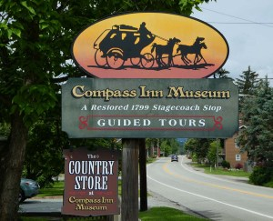 Sign: Compass Inn Museum showing a stagecoach