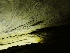 The water responsible for the caverns leave lines and dimpling from their flow