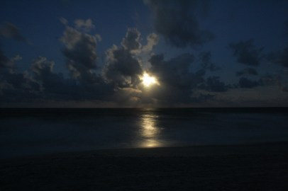 Evening walk on the beach under a Harvest moon
